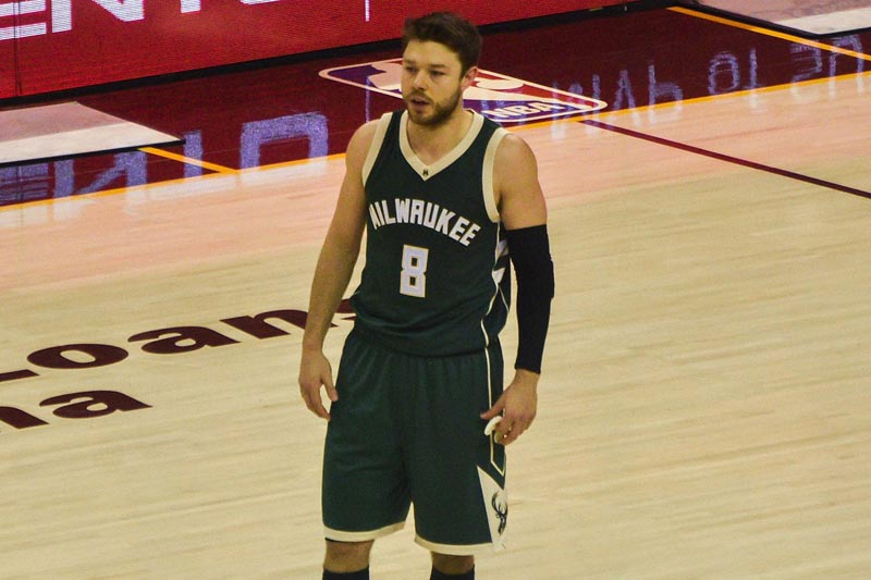 The Bucks' road uniforms are green.